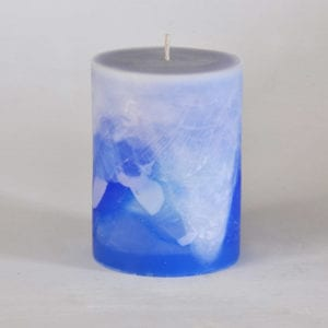 Large blue and white pillar candle